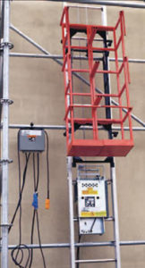 Scaffold Hoist on the side of a building.