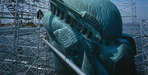 Detail of the Statue of Liberty's head with Scaffolding in the background.
