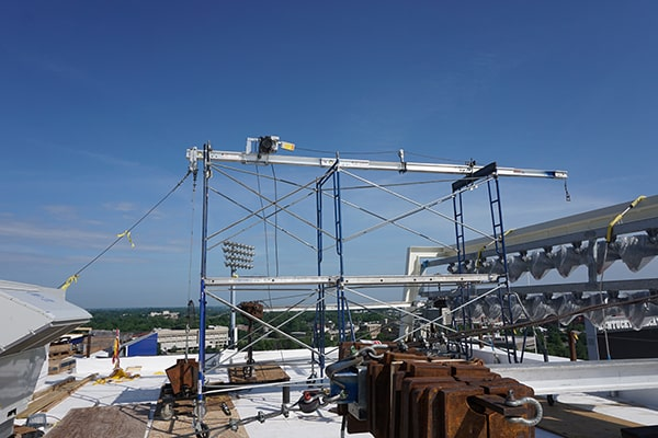 bismac material hoist on scaffolding towers